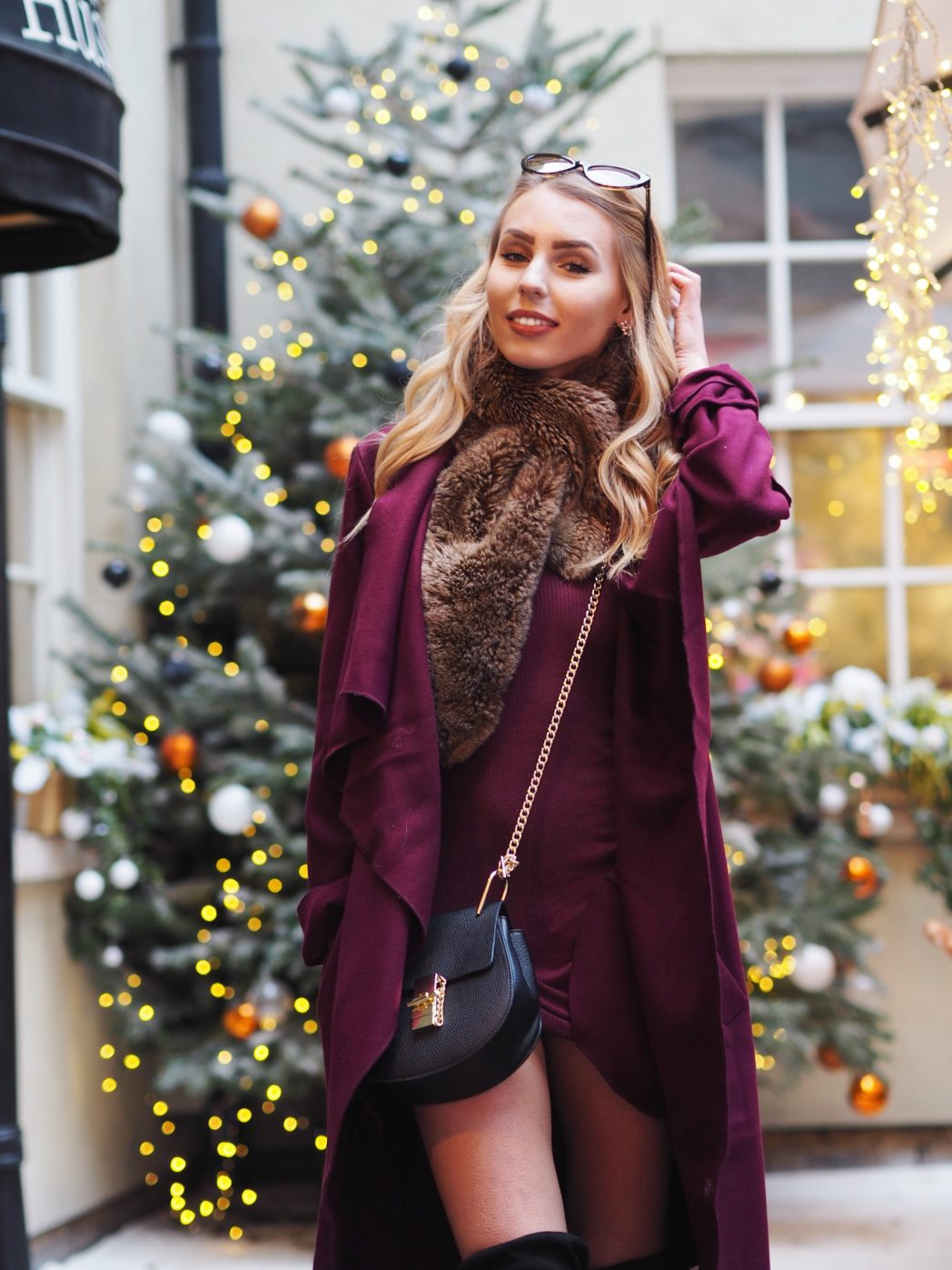 The Three Things I'm Aiming For In 2018 - How I'm Planning To SLAY 2018 | The Chic Pursuit is wearing a black Chloe Drew bag dupe with long, waterfall burgundy coat and burgundy dress, along with a faux fur scarf and black over the knee boots