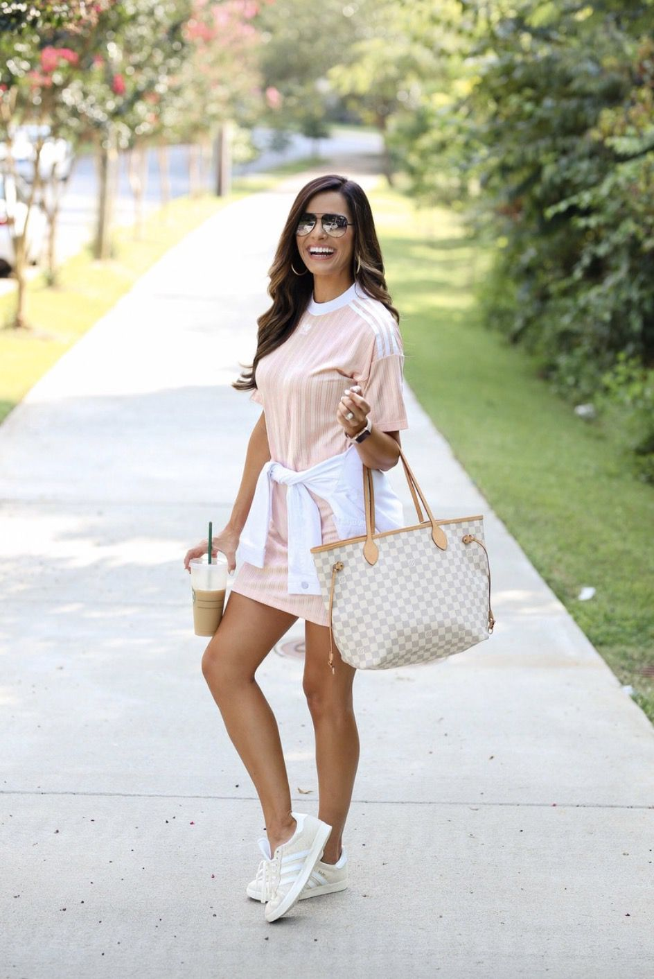 11+ Surprisingly Cute Sporty Outfits To Try: All athleisure lovers ahoy! Check out these sporty chic outfits, casual outfits and stylish gym outfits to get inspired for the new season. | Pink T-Shirt dress with nude sneakers and LV Neverfull bag - perfect for airport outfits. Image ©MumuAndMacaroons #sportyoutfits #casualoutfits #athleisure #airportoutfits