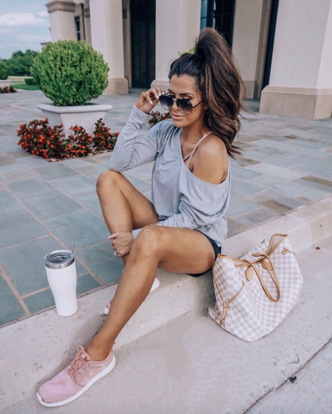 11+ Surprisingly Cute Sporty Outfits To Try: All athleisure lovers ahoy! Check out these sporty chic outfits, casual outfits and stylish gym outfits to get inspired for the new season. | Grey off shoulder sweater, pink sneakers and Louis Vuitton Neverfull outfit - perfect for airport outfits. Image ©EmilyAnnGemma #sportyoutfits #casualoutfits #athleisure #airportoutfits