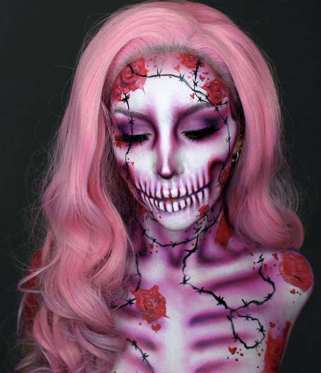 41 Most Jaw-Dropping Halloween Makeup Ideas That Are Still Pretty: Pink Skull Makeup / Click though to see more awe inspiring pretty Halloween makeup looks, gorgeous Halloween makeup and Halloween costumes. #halloweenmakeup #halloweenmakeuppretty #halloweencostumes #halloweenmakeupinspo #pinkskullmakeup #skullmakeup