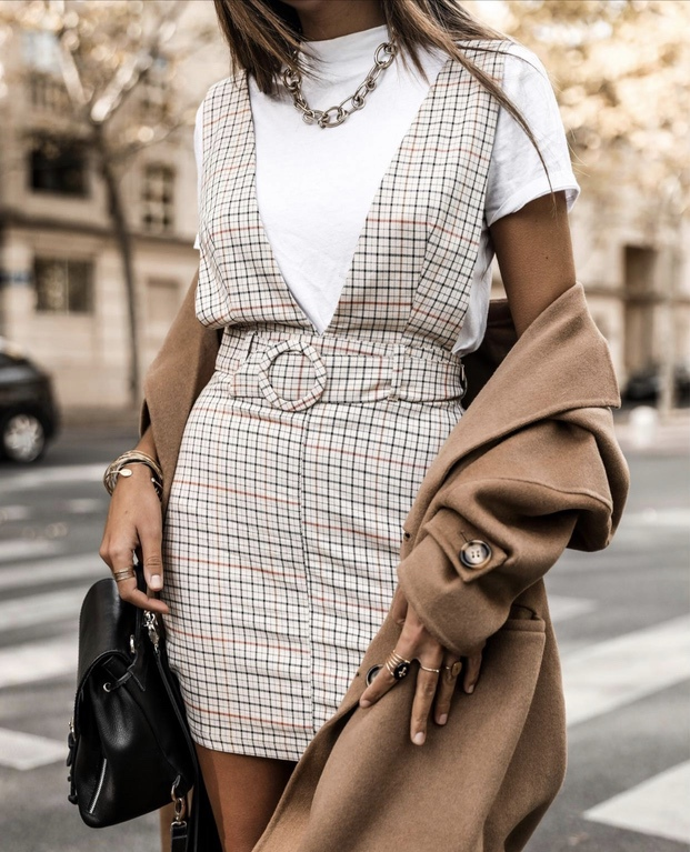 17 Trendy winter street style outfits and outfit ideas to step up your game this fall and winter: Plaid Dress Look. These winter street style looks are perfect to cosy up with in any urban city. Click over to the article and get inspired by more casual winter fashion looks! Image © JuneSixtyFive. #winterfashion #winteroutfits #streetstyle #plaid