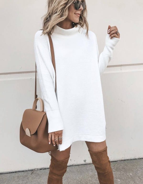 21+ Winter Outfits To Copy ASAP: White sweater dress with tan over the knee boots. These casual winter outfits will keep you warm when other cold weather outfits may fail you. Check out these over the knee boot outfit looks, sweater outfits and other winter fashion outfits from the biggest fashion bloggers to get inspired now! Image ©CellaJaneBlog #winterfashion #winteroutfits #casualwinteroutfits #sweaterdress