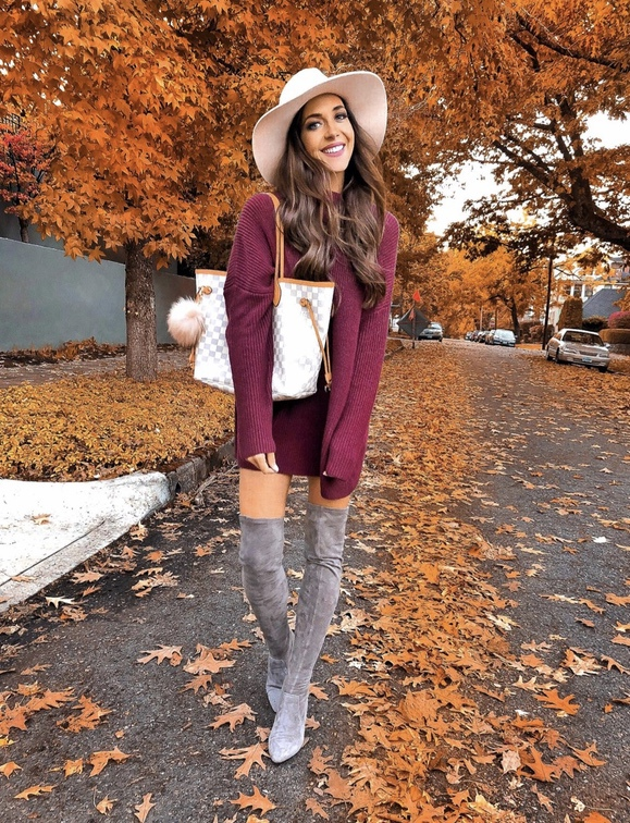17 Trendy winter street style outfits and outfit ideas to step up your game this fall and winter: Burgundy sweater dress with grey over the knee boots. These winter street style looks are perfect to cosy up with in any urban city. Click over to the article and get inspired by more casual winter fashion looks! Image © LC_Steele. #winterfashion #winteroutfits #streetstyle #overthekneeboots #sweaterdress