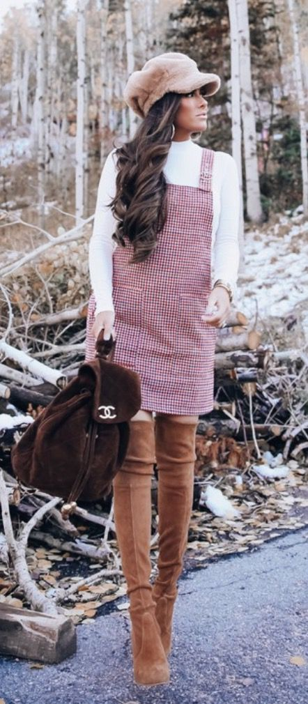 17 Trendy winter street style outfits and outfit ideas to step up your game this fall and winter: Plaid Overalls with Over The Knee Boots. These winter street style looks are perfect to cosy up with in any urban city. Click over to the article and get inspired by more casual winter fashion looks! Image © EmilyAnnGemma. #winterfashion #winteroutfits #streetstyle #overalls #plaid #overthekneeboots